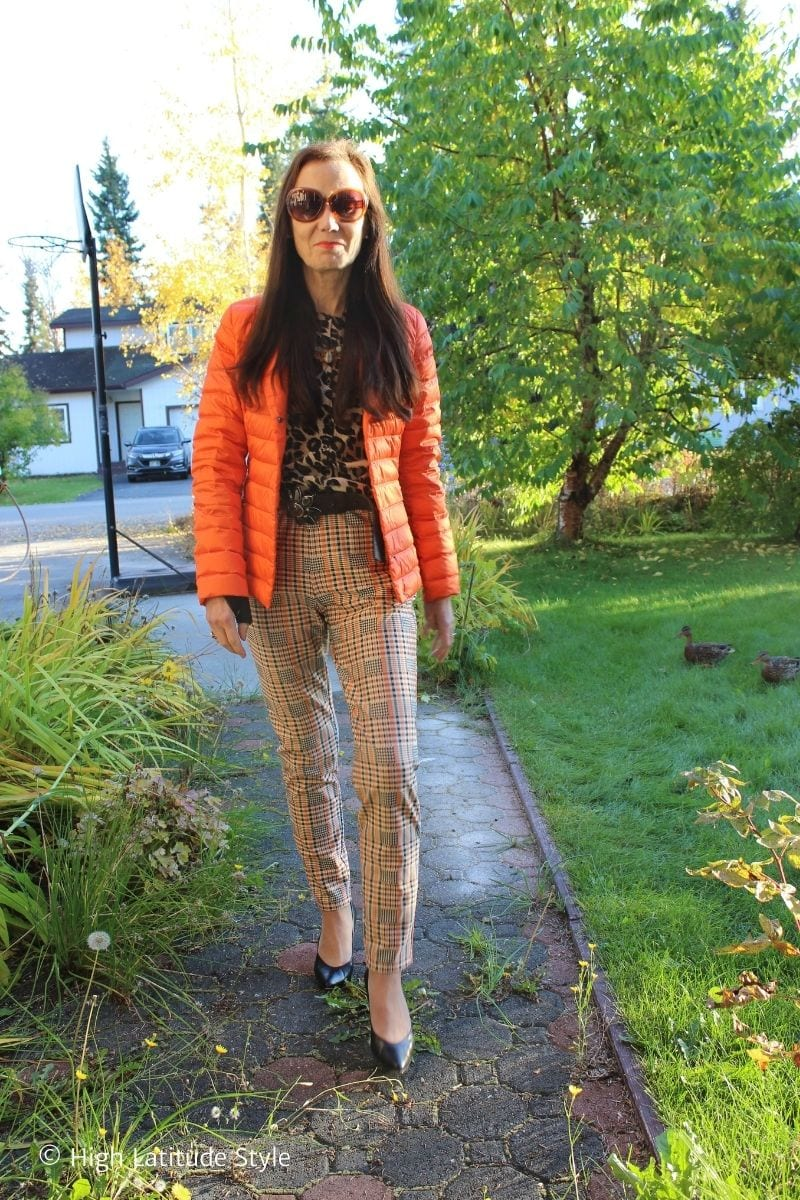 Alaskan blogger in orange blazer, plaid pants, leopard top, heels