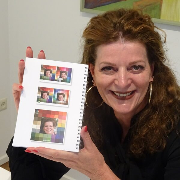 Nancy Baten holding an autumn color palette