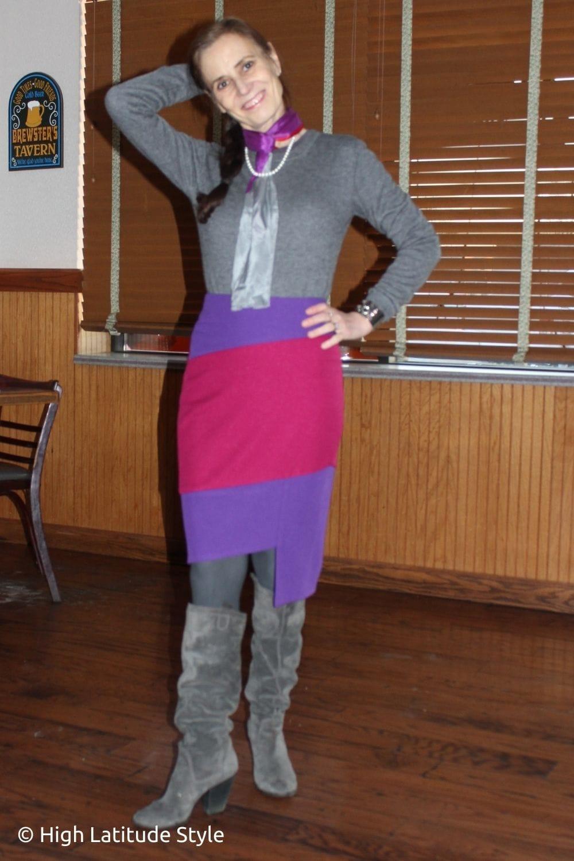 stylist in purple, fuchsia, gray skirt, sweater, scarf, tights, boots classic winter look