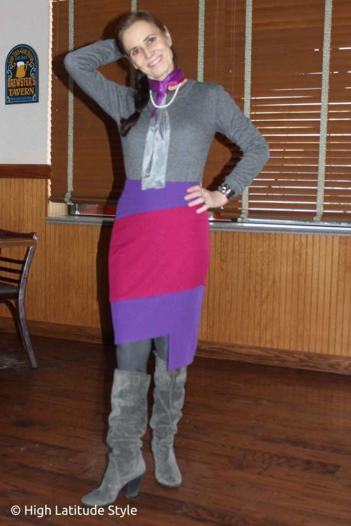 stylist in purple, fuchsia, gray skirt, sweater, scarf, tights, boots classic winter look
