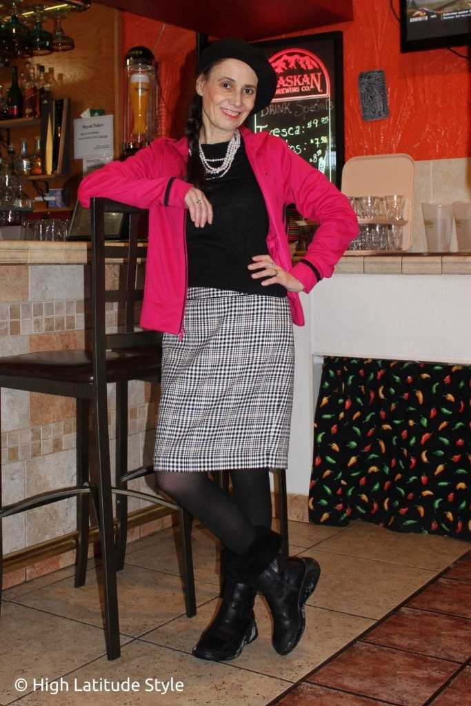 style blogger in fuchsia Adidas jacket, houndstooths skirt, semi-opaque tights