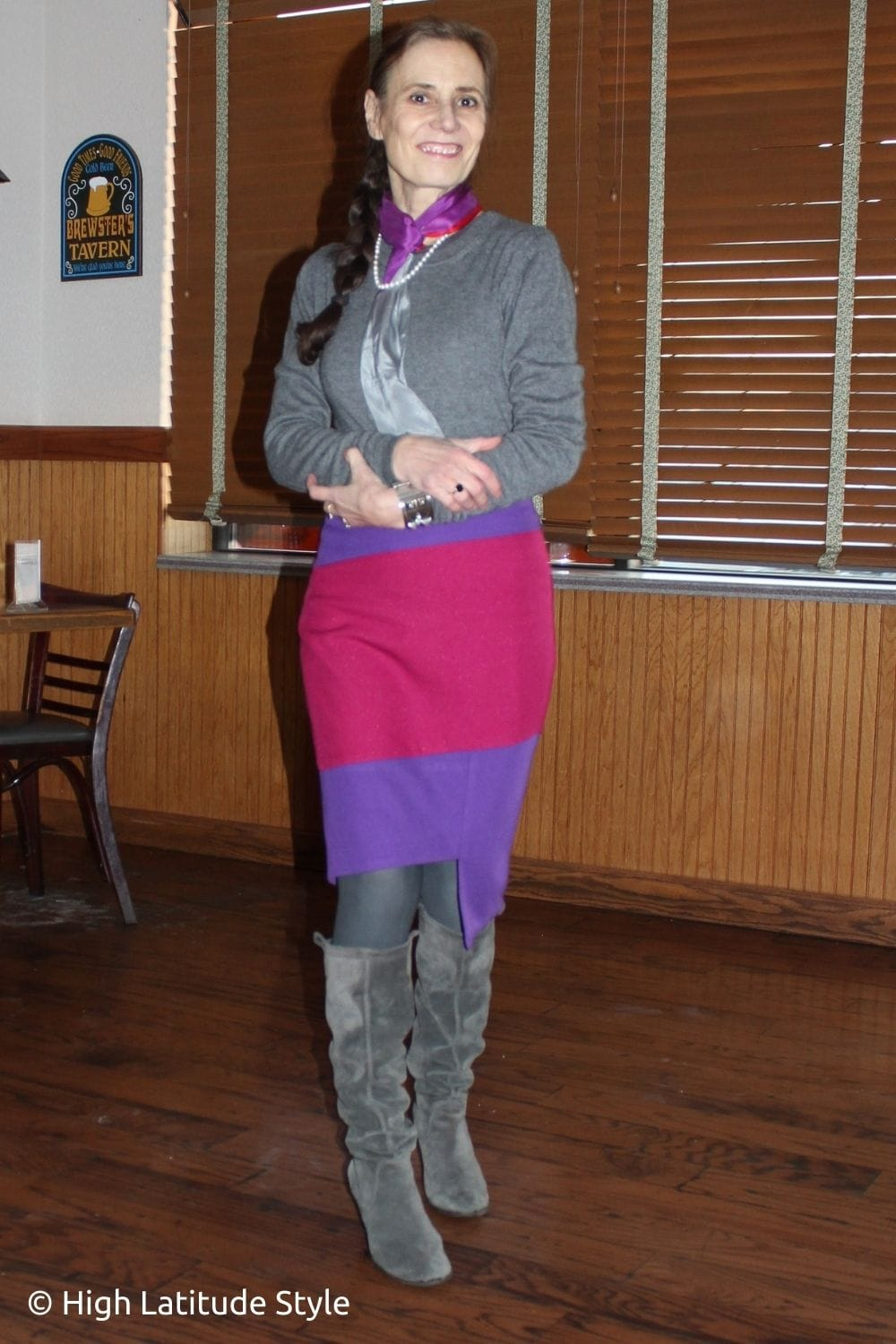 style blogger in three color winter outfit with skirt, and heel boots sweater, tall gray boots, and scarf, braided ponytail