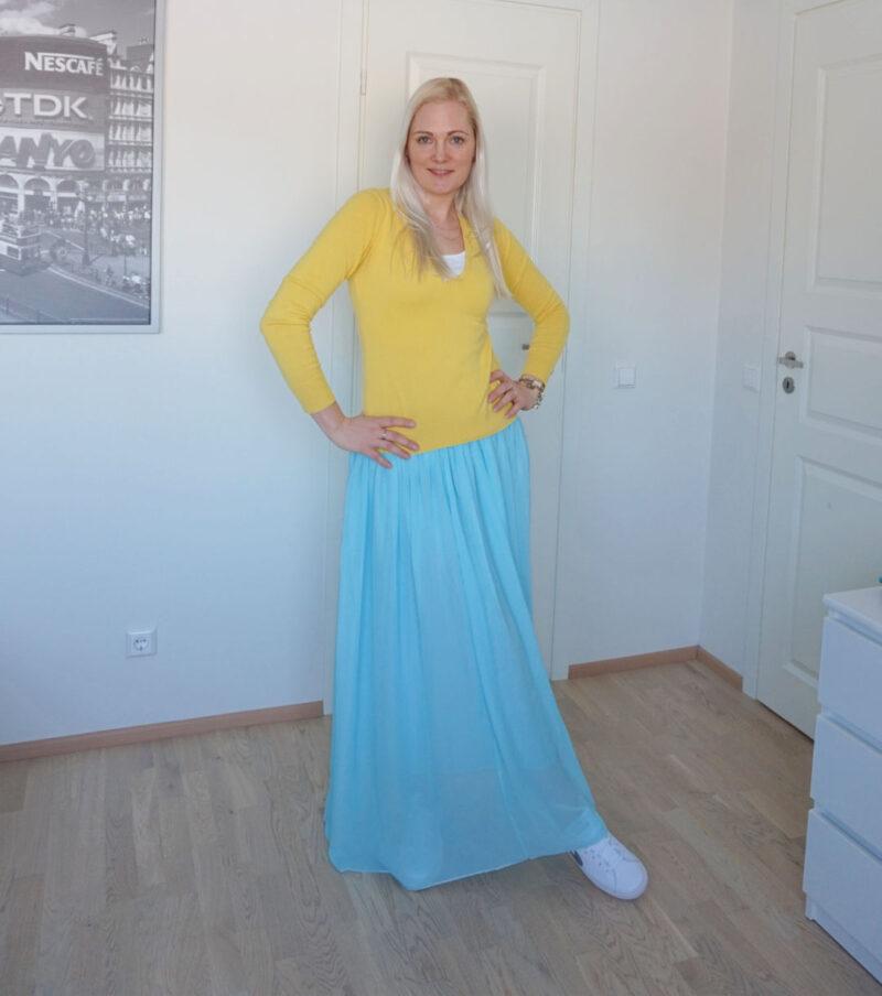 beauty blogger Leelo in light blue maxi skirt, yellow sweater