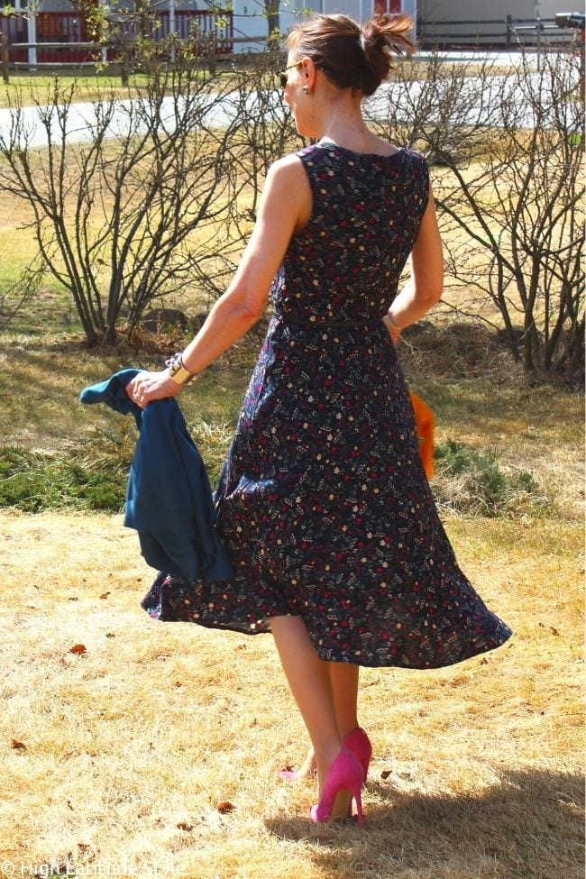 back view of navy floral print apricot dress