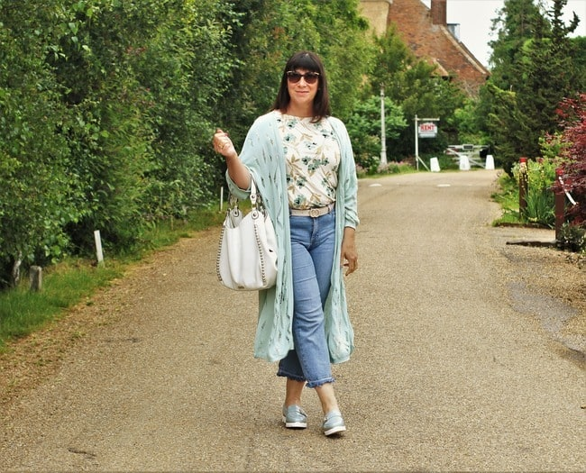 Jacqui in duster, cropped jeans floral top