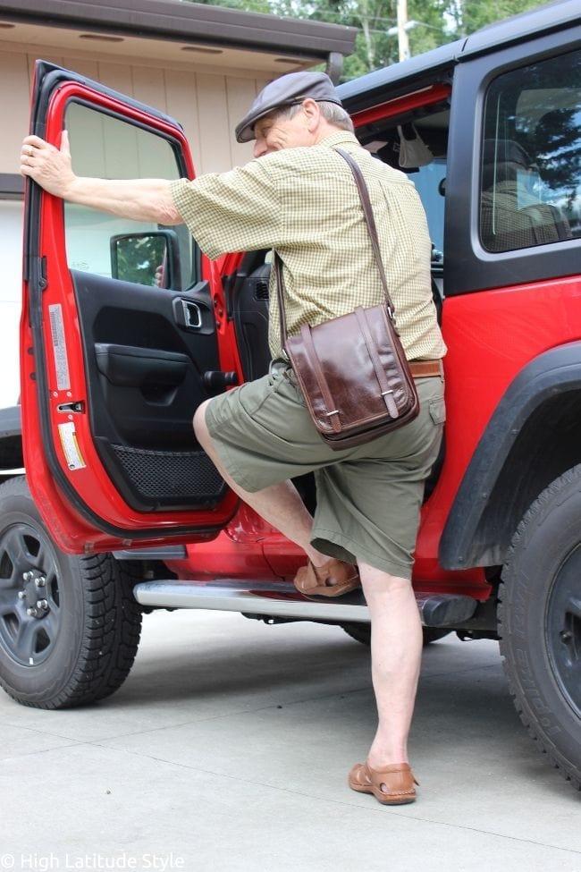stylish man getting into a Jeep