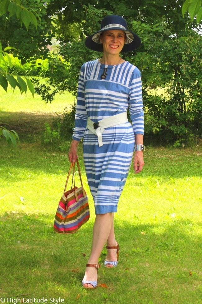 influencer in striped chic sun safe midi dress vacation look for shopping