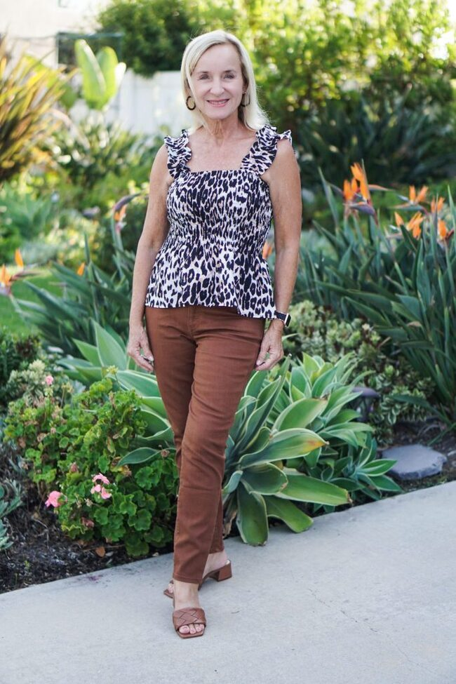 Darlene in leopard print top and brown trousers became top of the World Style winner