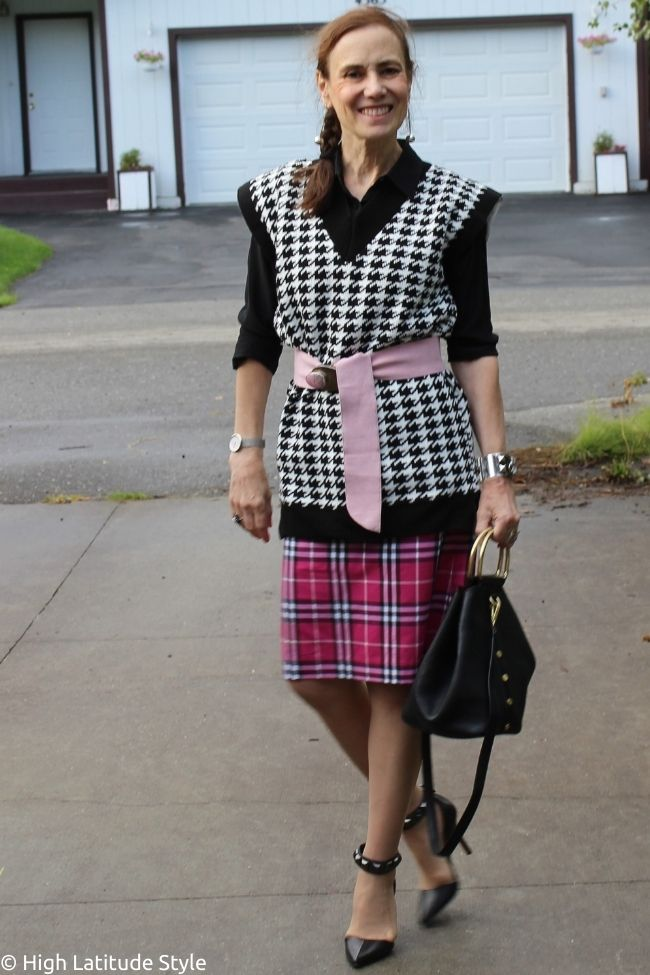 Casual Friday outfit idea with oversized vest, knee length skirt, silk shirt, belt