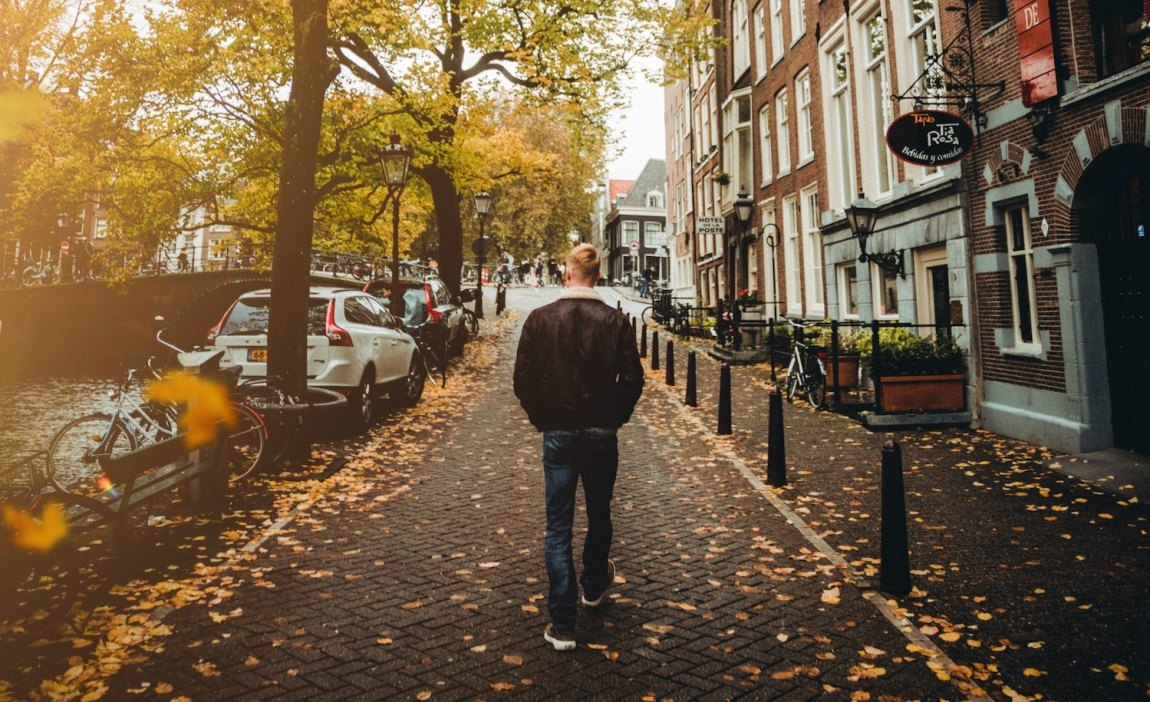 A highly sensitive person walks down the street.