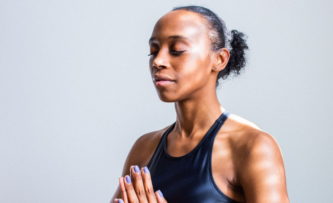 A yoga teacher practicing calmness during times of difficulty