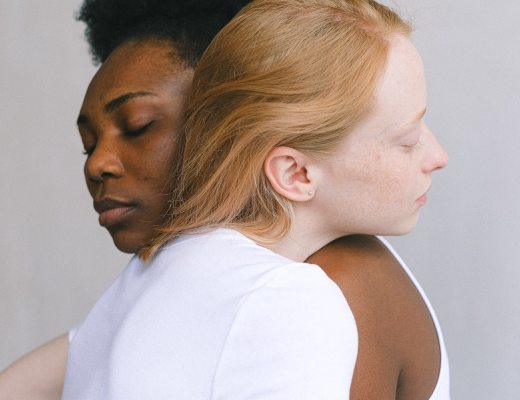 A woman hugging an empath who is crying as she deals with grief and loss.