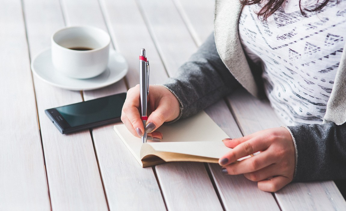 A highly sensitive woman writes in a journal