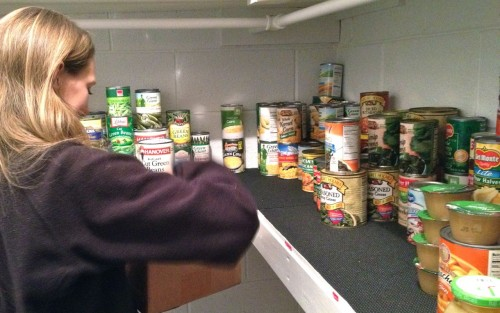 Cara Stillwell organizes food pantry