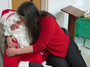 Barb Kissing Santa Clause at last year's social