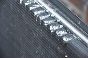 bent fins on condenser coils