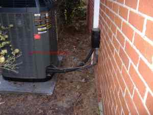 Air Conditioner Service and Repair - Line Set Runs Neatly Up the Side of the House to the Attic