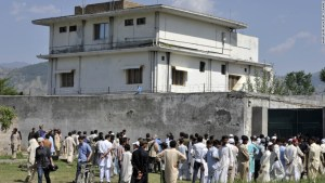 Pakistani media personnel and local residents gather outside the hideout of Al-Qaeda leader Osama bin Laden following his death by US Special Forces in a ground operation in Abbottabad on May 3, 2011. The bullet-riddled Pakistani villa that hid Osama bin Laden from the world was put under police control, as media sought to glimpse the debris left by the US raid that killed him. Bin Laden's hideout had been kept under tight army control after the dramatic raid by US special forces late May 1, 2011 in the affluent suburbs of Abbottabad, a garrison city 50 kilometres (30 miles) north of Islamabad.  AFP PHOTO/ AAMIR QURESHI (Photo credit should read AAMIR QURESHI/AFP/Getty Images)