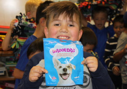 Travis Garcia packs up doggie treats.