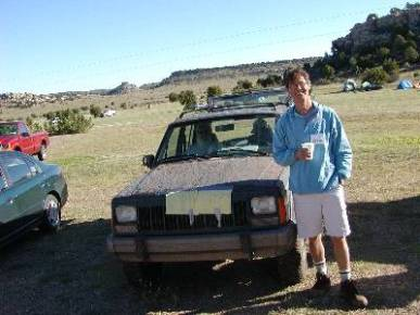 Fred Dale in front of a mud spatter jeep during the Highpointers 2002 Convention at Black Mesa, Oklahoma
