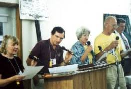 Highpointers were always singing. Strangely in the words provided in a sheet by the Elliotts the Maryland state song has references to Backbone Mountain. From left are Lillian and Gene Elliott, Mary and Joe Howard, and the Mayor of Oakland.