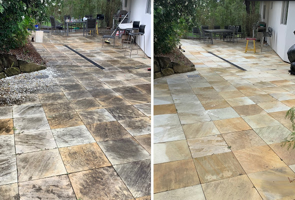 Pressure Cleaning a Sandstone Tiled Courtyard