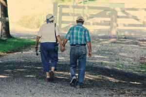 Couple walking on gravel path