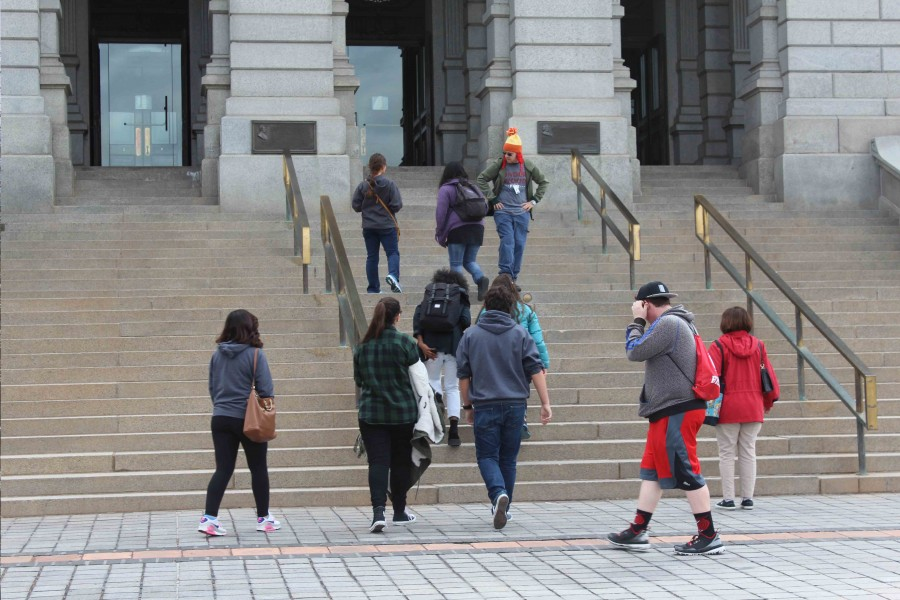 """Students on the trip got a chance to explore Downtown Denver Sunday morning before catching their flight back. Here, they explore the City Capitol and its """"Mile High Steps"""". (Veronica Godoy)"""