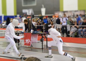 Isaac Gomez (right) fencing at Nationals