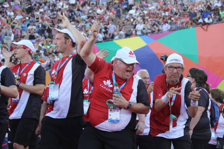 Team Canada brings the fire to the Opening Ceremony, and the crowd responds with cheers of their own on Saturday.
