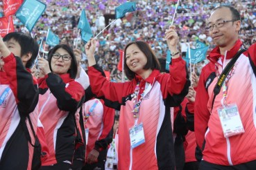 Hong Kong athletes carry their country flags with pride during the Special Olympics World Games Opening Ceremony on Saturday.