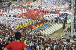 A fan looks on at the hundreds of athletes marching into the Coliseum and taking their seats during the Special Olympics World Games Opening Ceremony on Saturday.