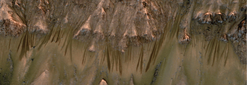 The dark lines on the slopes are RSLs. They found to contain calcium perchlorate - a compound that attracts and holds water from its environment. Photo courtesy of planets.ucla.edu.