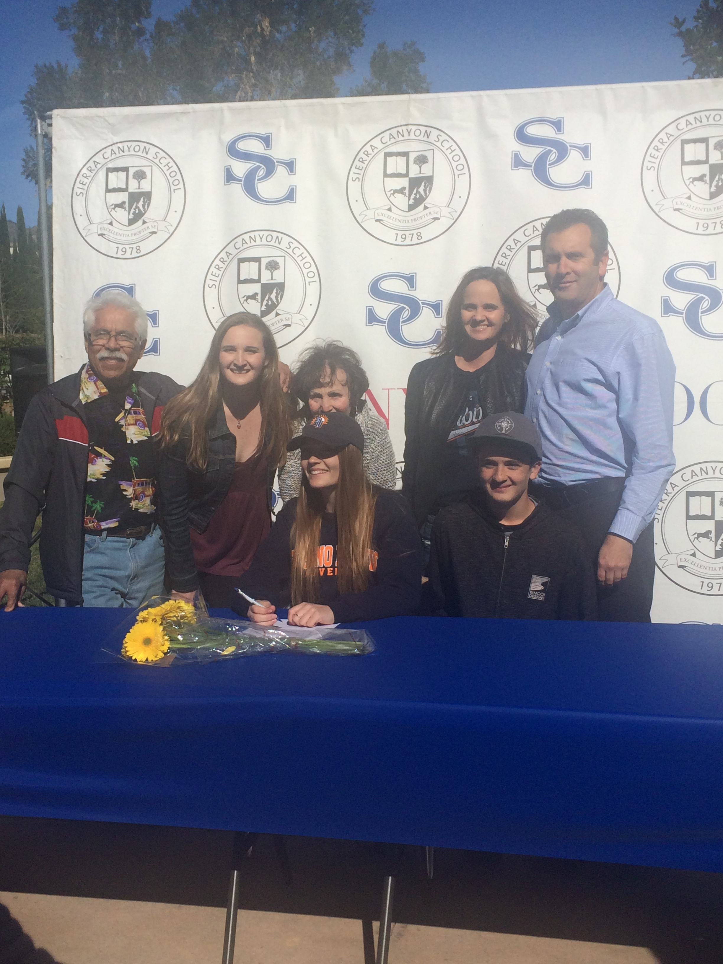 Peyton Shaffer (Center sitting) is surrounded by her family for many of the pics taken on Signing Day