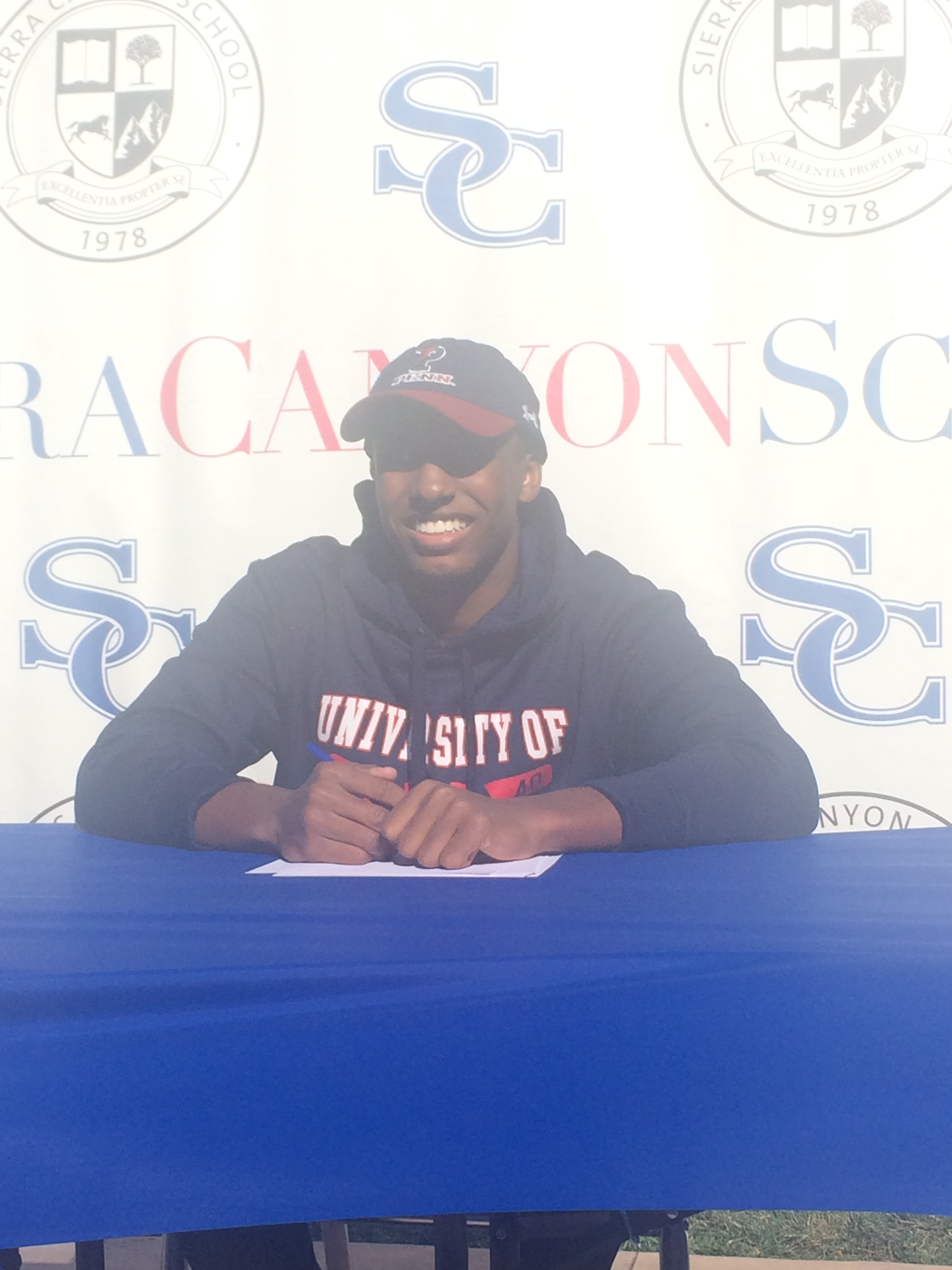 Eric Markes, one of the two football players signing to Penn, poses for Pictures