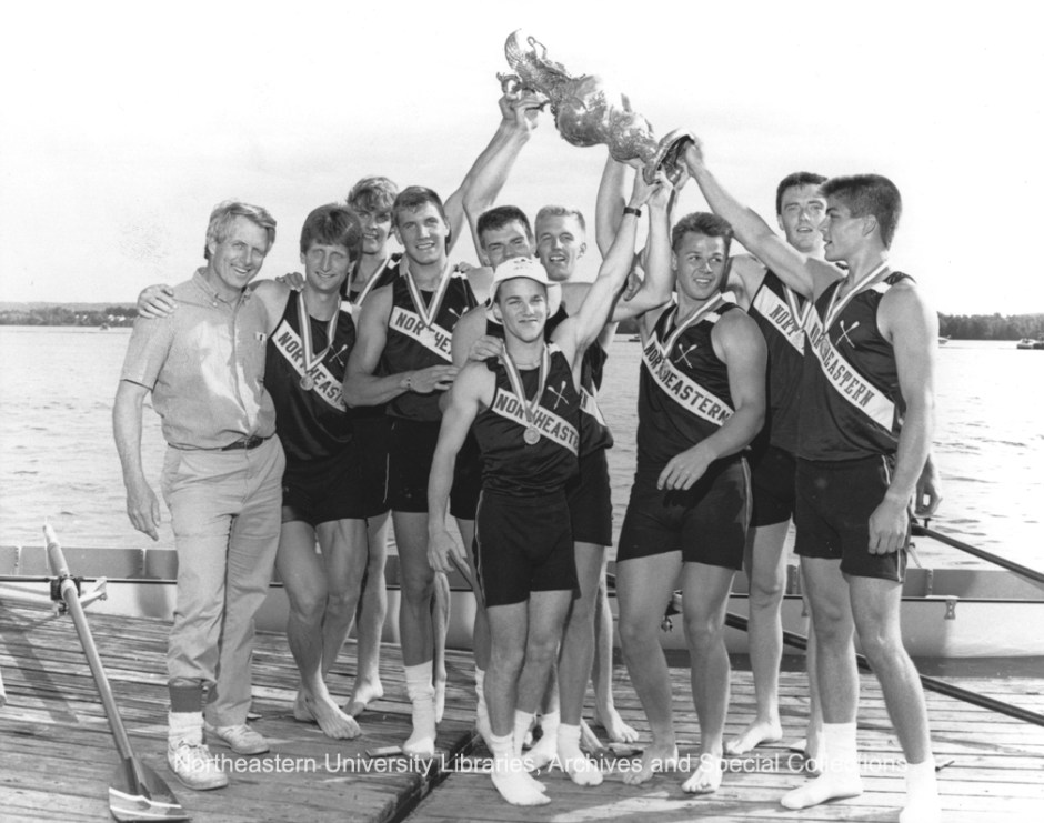 Korb, pictured second from the right, holds a trophy with his teammates proudly after winning a match.