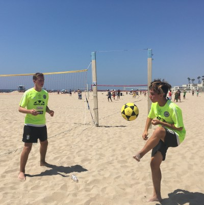 Hudson Ashcraft, left, and Daniel Noble, right, practice passing after their match.