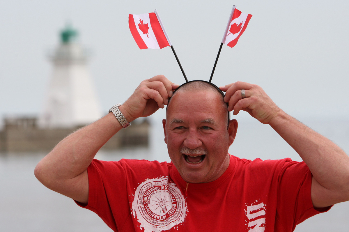 happy_canadian_with_flags.jpg