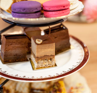 A selection of macarons, Hazelnut Fan Slice and Brownie Mousse Slice