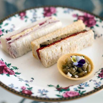 Turkey, brie & cranberry finger sandwich and Smoked eggplant & goats cheese tartlet