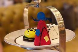 A selection of five miniature gateaux inspired by famous artists