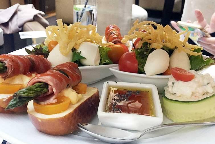 Caterpillar; cherry bocconcini & tomato on fresh green salad boat Alice in Wonderland