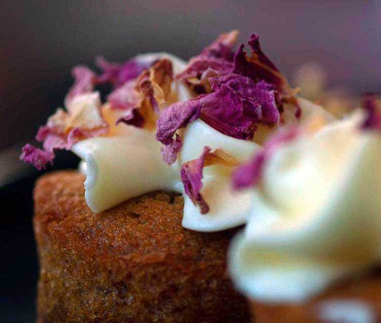Carrot cake with rose petals sprinkled on top
