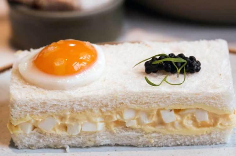 Classic egg mayonnaise, quail egg, avruga caviar on white bread