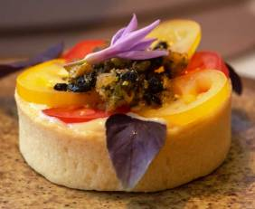 Aged Cambray cheddar tart with heirloom tomato, olive