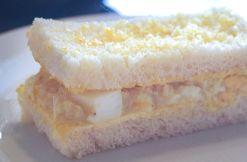 Classic egg curry mayonnaise, quail egg and avruga on white bread