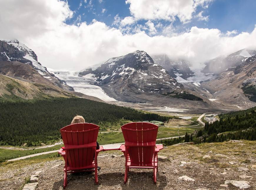 Enjoy a red chair moment and a view to the Columbia Icefields part way up Wilcox Pass