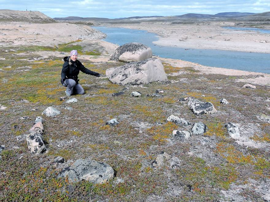The author admires an ancient Thule tent ring Ukkusiksalik National Park. The Thules were ancestors of Canada's Inuit. Photo credit: Marlis Butcher
