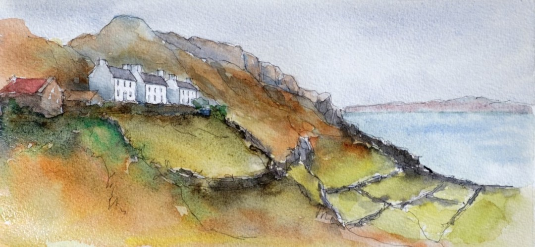 Cottages clinging to a high cliff with fields