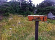 The trail rounds the private property.